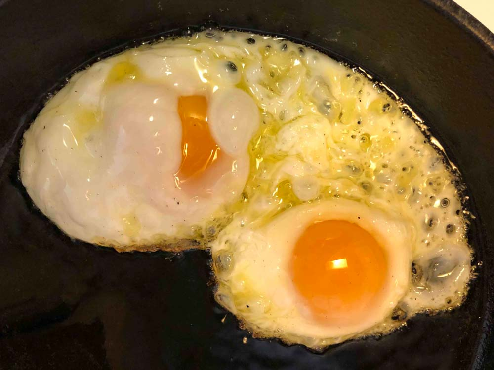 Food Cloudy-Eggs-in-a-cast-Iron-skillet-with-Avocado-Oil